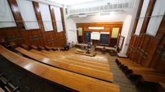 People leave auditorium after lecture in university. Top view - stock footage