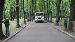 Men enclose area with truck for working in park. Stock Footage