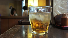Glass Of Plum Wine With Ice At Tokyo Restaurant Shinjuku Stock Footage