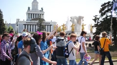 Stock Video Footage of Youth near Friendship of Nations fountain in park of VDNKH.