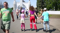 Family skating in park of VDNKH in Moscow, Russia. Stock Footage
