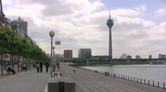 Dusseldorf river promenade with Telecom tower in the background Stock Footage
