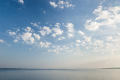 Tranquil lake scene at sunrise - stock photo