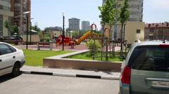 Cars are parking near playground of residential complex Stock Footage