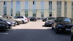 Cars are parking near new residential complex at sunny day Stock Footage