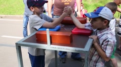 Kids Arm Wrestling competition in Sokolniki park in Moscow. - stock footage
