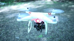 Quadrocopter with GoPro camera flies in forest. Stock Footage