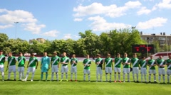Football field with players before game at Spartakovec stadium Stock Footage