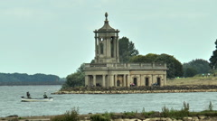 Normanton Church and still fishing boat on Rutland Water. - stock footage