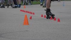 Roller skater man foot ride on one wheel slalom. 4K Stock Footage