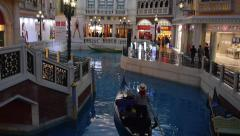 Gondola ride down the canals of Venice inside the Venetian Macao Resort Hotel Stock Footage