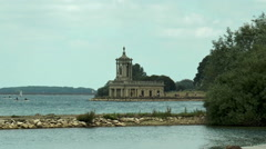 Normanton Church and visitors, activities on Rutland Water (zoom out). - stock footage