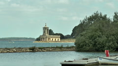 Normanton Church and visitors, Rutland Water (zoom in). - stock footage