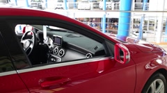 Beautiful new shiny red car with opened window in big store Stock Footage
