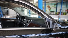 Beautiful new shiny black car with opened window in store Stock Footage
