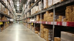 Many long shelves with cardboard boxes in warehouse Stock Footage