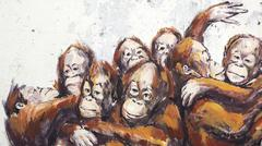 Orangutans in a Wheelbarrow Street Art Mural in Kuching, Sarawak, Malaysia - stock photo