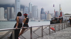 Two female friends hang out at HK harbor 4K Stock Footage