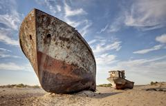 Stranded ships at the port of Moynoq or Muinak Aral Sea Karakalpakstan Stock Photos