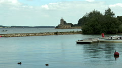 Normanton Church and activities on Rutland Water. - stock footage