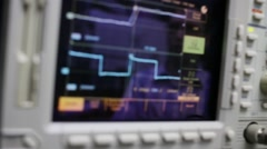 Display of modern grey digital oscilloscope with graphics Stock Footage