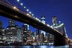 Stock Photo of Brooklyn Bridge views of the East River onto the Manhattan skyline Downtown