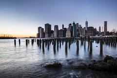 Stock Photo of ier at Brooklyn Bridge Park with view of the East River and the skyline of