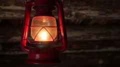 Old-fashioned red lamp hanging from ceiling in dark room Stock Footage