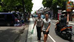 Walk on Jalan Melasti, street at Kuta, Bali island Stock Footage