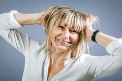 Smiling confident middle-aged blond woman - stock photo