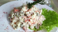 Portion of salad on white plate decorated with a dill sprig. Stock Footage