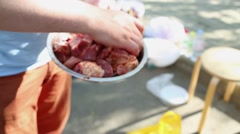 Man holds metal bowl full of meat pieces and mix them with spices Stock Footage