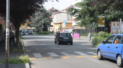 Street in the suburb of Milan, unhurried flow of cars Stock Footage