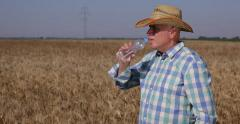 Agriculture Worker Sweating Sweating Dehydrated Drink Water Hot Day Wheat Crop Stock Footage