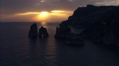 AERIAL Italy-Flight Past Rocks At Sunset Stock Footage