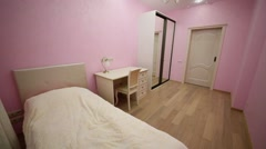 Bedroom decorated in pink colour, mirrored wardrobe, bed Stock Footage
