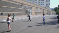 Children play ball near the wall at residential complex Elk Island Stock Footage