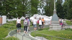 Turists walk through the miniatures of old Italian Town in park Leolandia Stock Footage