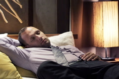 Young businessman waking up from a nap NTSC Stock Footage