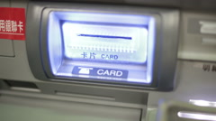 Bank card ejecting from ATM chnese instructions shot from side Stock Footage