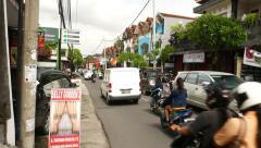 Busy traffic on Jalan Tangkuban Parahu, Kuta town, Bali Stock Footage