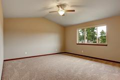 Large master bedroom with carpet. - stock photo