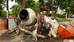 Loudly old concrete mixer, gasoline engine rattle Stock Footage