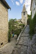 Medieval alley and spire Crestet Vaucluse Provence Alpes Cote dAzur France Stock Photos