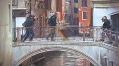 Venice city scene with bridge and walking people Stock Footage