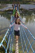 Family visiting the Erlebnispark Wasser Fisch Natur adventure park at Murner - stock photo