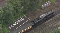 AERIAL United Kingdom-Pickering, Steam Railway And Castle Stock Footage