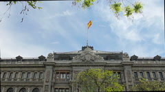 Spanish flag over the library of Madrid Stock Footage