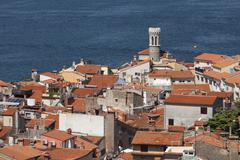 View of the historic centre with lighthouse Piran Istria Slovenia Europe - stock photo
