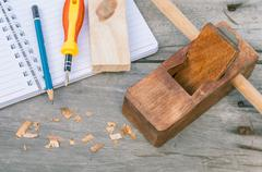 The carpenter plane and wood shavings for woodwork. - stock photo